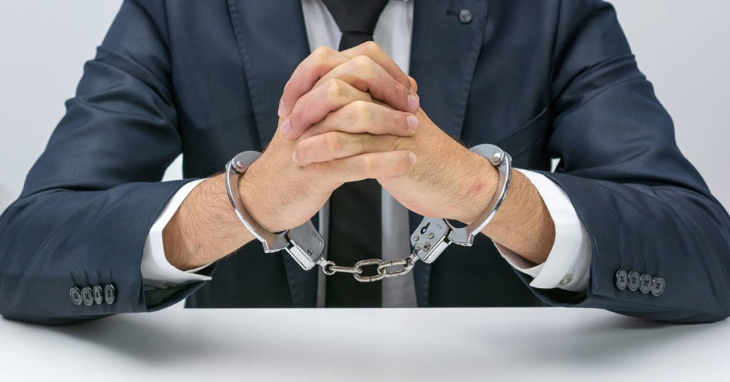 white-collar business man in cuffs with hands together
